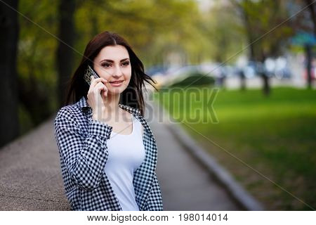 Young Pretty Stylish Woman Talking On Smart Phone In The City Pa