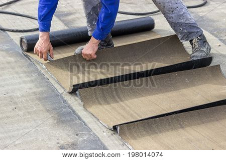 Insulation Worker Cutting Insulation Bitumen Material Rolls