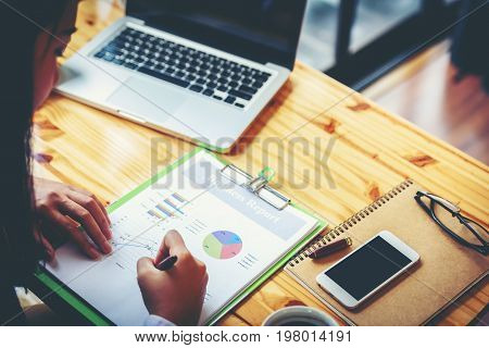 Asian Business Women Are Reading And Writing Trading Reports. Vintage Tone And Soft Focus.