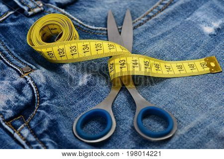 Scissors On Jeans Crotch, Close Up.