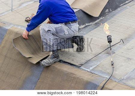 Insulation Worker With Propane Blowtorch