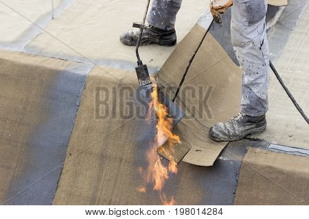 Insulation Worker With Propane Blowtorch 2