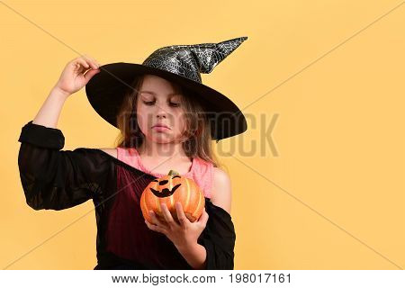 Halloween And Costume Party Concept. Child In Witch Costume