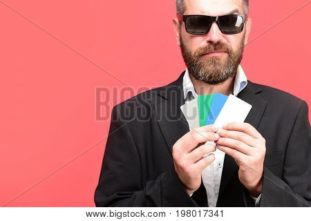 Business And Luck Concept. Guy With Tricky Face And Sunglasses