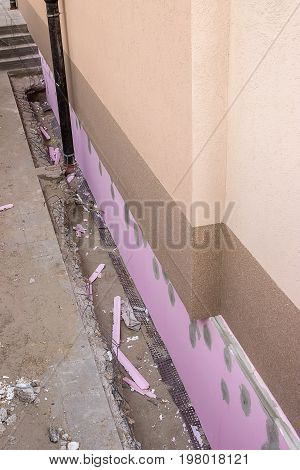 Trenching Around Building For New Layer Of Foam Insulation 2