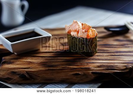 Delicious Fresh Sushi Gunkan With Scallop Served On Wooden Rusti