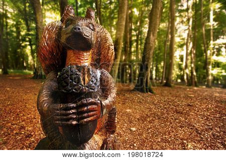Foresta Umbra Italy 14 July 2017 - A wooden squirrel hold an acorn in the Foresta Umbra woods in the Gargano National Park.