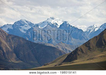 Views of mountain peaks glaciers gorges in Tien Shan Kyrgyzstan.