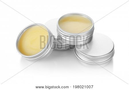 Containers with dry perfume on white background