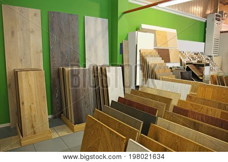 Assortment of laminated flooring samples in hardware store