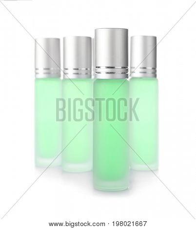 Bottles of modern perfume on white background