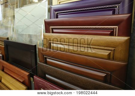 Assortment of wooden samples for furniture in hardware store, closeup