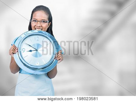 Digital composite of Woman holding clock in front of staircase