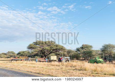 OTJIWARONGO NAMIBIA - JUNE 19 2017: Baling machines next to the road near Otjiwarongo used to bale the grass cut next to the road