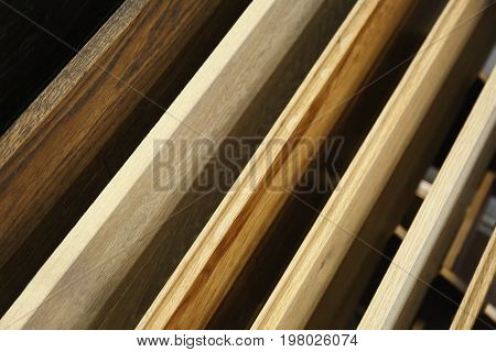 Assortment of laminated flooring samples in hardware store, closeup