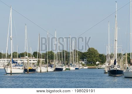 Wickford Rhode Island USA - September 3 2007: Lines of sailboats lining waterfront in Wickford Cove