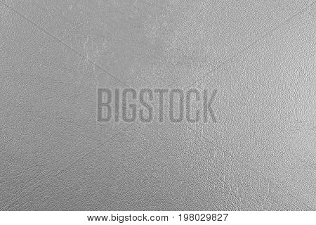 Gray background with spotlight. Grey leather texture background surface.