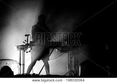 Silhouette Of A Keyboardist In Stage Lights