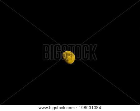 Photo of a waxing gibbous moon against a black sky