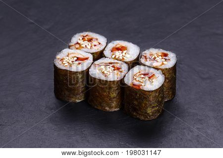 Traditional Sushi Rolls With Smoked Eel, Unagi Sauce And Sesame