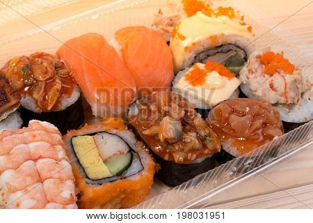 Japanese Food Sushi In Plastic Box On Japanese Table. Set Of Sushi, Original Style Japanese Food Pac