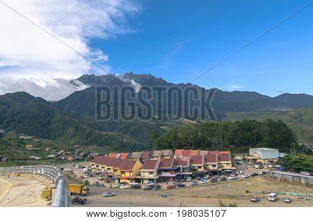 Majestic mountain Kinabalu with blue sky background at Ranau,Sabah,Borneo.Nature view of Borneo tropical jungle.
