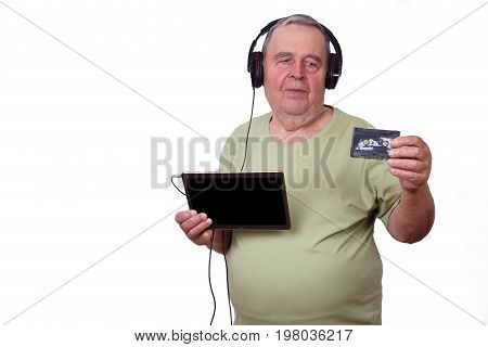 Portrait Of Old Man Listening To Music In Earphones Using A Tabl