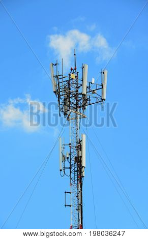 Telecommunication tower against blue sky day, technology concpet
