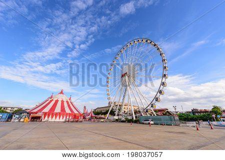 Ferris wheel in amusement park with blue sky