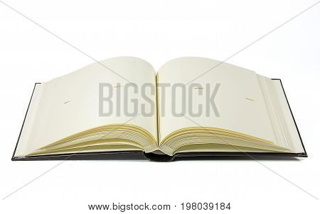 Opened photo book with blank pages on a white background