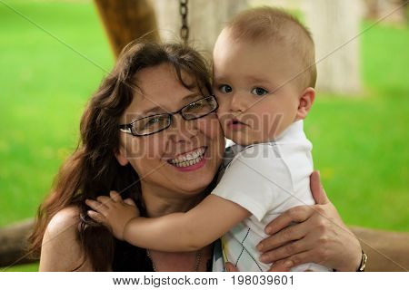 portrait of happy grandmother with grandson on the banch