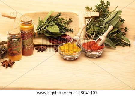 Wooden table of colorful spices. Set of various aromatic colorful spices and herbs