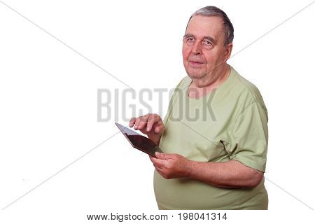 Portrait of senior man pensioner using tablet typing message isolated. Simple and apprehensible technologycomfort care connection poster