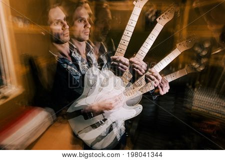 Creative guitarist portrait in double exposure. Music recording studio, split personality, dark psychological condition