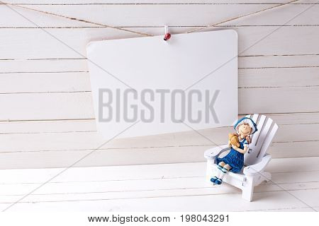 Decorative wooden toys in coastal living or summer vacation theme and empty tag on wooden background. Selective focus. Place for text.