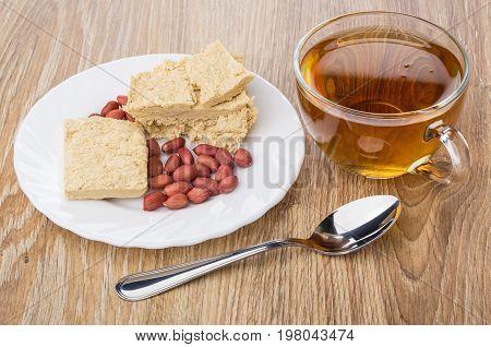Peanuts And Pieces Of Peanut Halva, Tea And Teaspoon