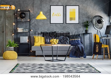 Optimistic teenager's room with gray wall furniture and yellow accents