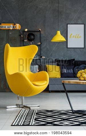 Gray living room with yellow details armchair sofa and coffee table