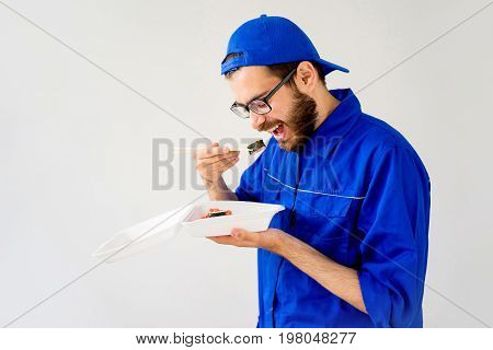 Delivery guy eating rolls he was supposed to give