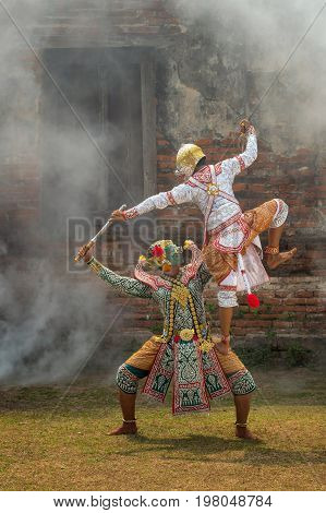 Khon pantomime performances action of Thailand a kind of Thai drama Hanuman Monkey fighting with Giant at Ayutthaya temple performing action concept