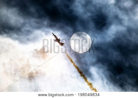 Airplane Fighter Against The Background Of The Solar Disk And Clouds
