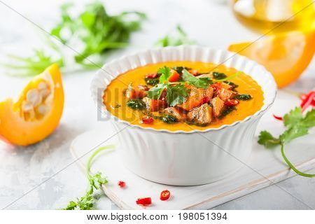 Pumpkin and sweet potato soup with coriander oil and chili pepper