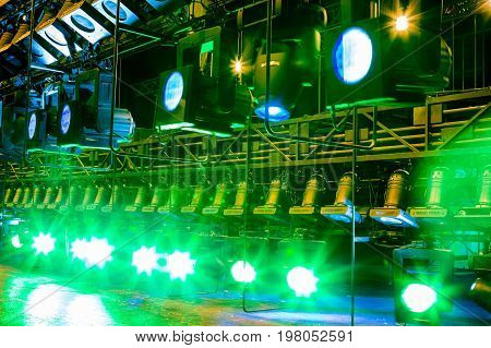 Spotlights & lighting equipment for the theater. Multi-colored lights.