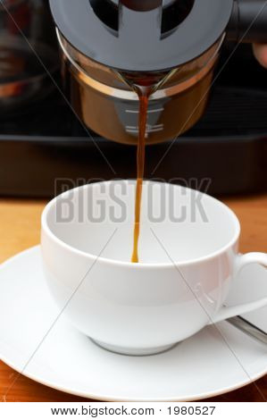 Coffee Being Pourn Into White Cup