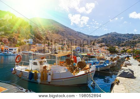 Old fishing Boats at Simi , the background of beautiful multi-colored buildings in island