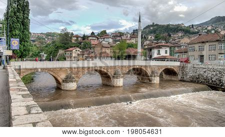 SARAJEVO, BOSNIA AND HERZEGOVINA - May 1 2014: Bridge on Miljacka river in Sarajevo the capital city of Bosnia and Herzegovina