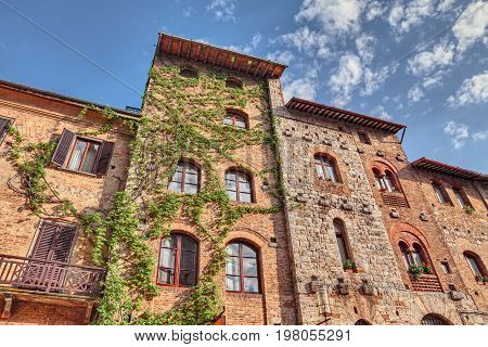 San Gimignano, Siena, Tuscany, Italy: ancient historic buildings in the old town of the medieval village