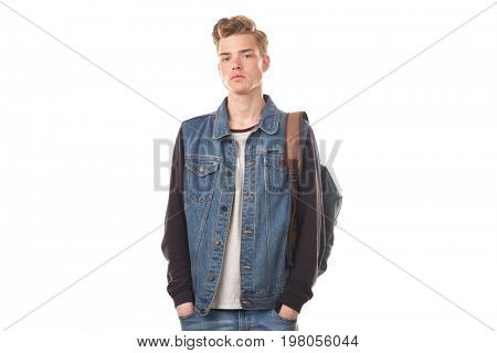 Portrait of schoolboy expressing emotions against white background