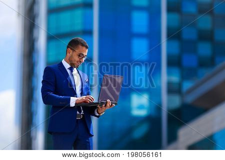 Competent Business Expert Business Man In Suit Holding Laptop Wh