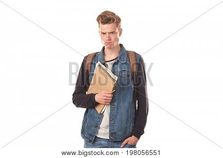 Portrait of schoolboy posing with notepads against white background